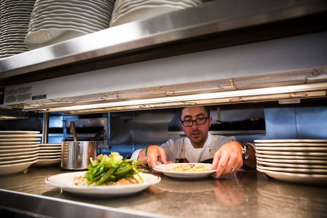 Chef-owner Vincenzo Betulia presents a lunch dish May 2017 at The French Brasserie Rustique on Fifth Avenue South in Naples.