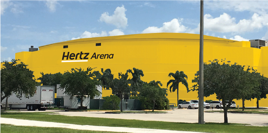 Rendering shows the original all-yellow color scheme proposed for Hertz Arena.