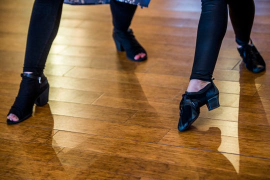 Catrina Eckel and Jason Lowrance take dance lessons from Hristina Spasova at the Enchanted Ballroom on Wednesday, Aug. 29, 2018. The couple is learning a choreographed routine for their wedding reception.