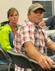Laura and Steve Trickle listen to residents discuss the Lost Lands Music Festival at Monday night's Licking Township Trustees meeting.