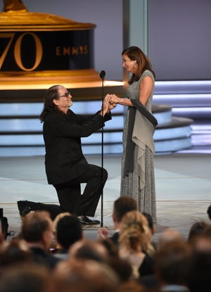 "Glenn Weiss proposes to his girlfriend after accepting the award for outstanding directing for a variety special for ""The Oscars"" at the 70th Primetime Emmy Awards on Monday, Sept. 17, 2018, at the Microsoft Theater in Los Angeles. (Photo by Phil McCarten/Invision for the Television Academy/AP Images)"