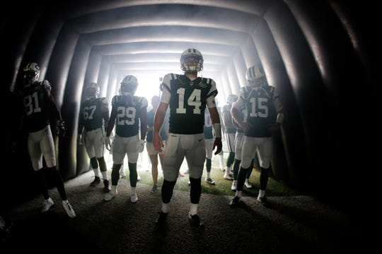 New York Jets quarterback Sam Darnold (14) waits with teammates before an NFL football game against the Miami Dolphins Sunday, Sept. 16, 2018, in East Rutherford, N.J.