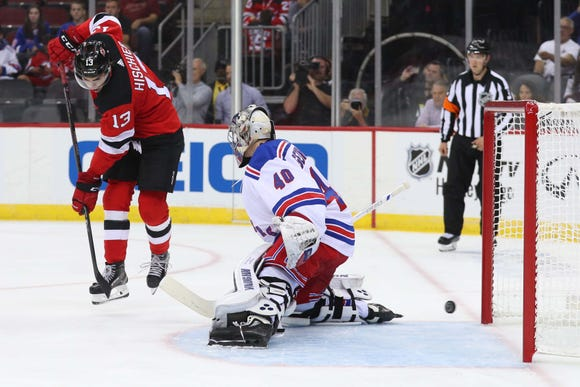 New York Rangers goaltender Alexandar Georgiev (40) defends his net through a screen by New Jersey Devils center Nico Hischier (13) during the second period at Prudential Center.