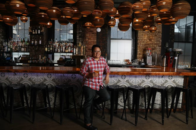 Owner and chef Dale Talde of Fort Lee in front of the bar with lights that are actually made from cardboard at this Jersey City restaurant.