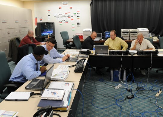 Second from left, Brian Gaine, former Don Bosco football player, works in the Miami Dolphins front office in 2008 under Bill Parcells, right, who is executive vice president of football operations.