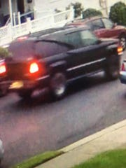 Police release photos of a Chevy Suburban wanted in a Garfield hit-and-run