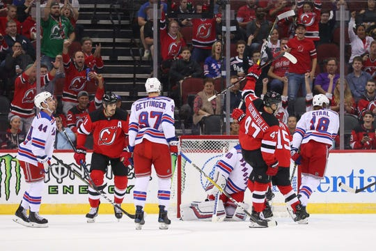 New Jersey Devils left wing John Quenneville (47) celebrates his goal during the first period of their game against the New York Rangers at Prudential Center.