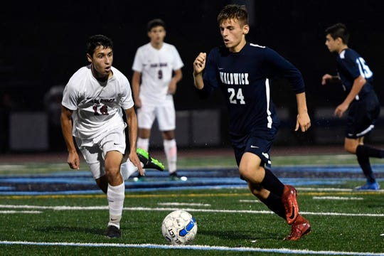 Waldwick's Lucas Ruehlemann (24) runs with the ball with pressure from Park Ridge's Robert Nicolich (16) during a boys soccer game in Waldwick, NJ on Monday, September 17, 2018.