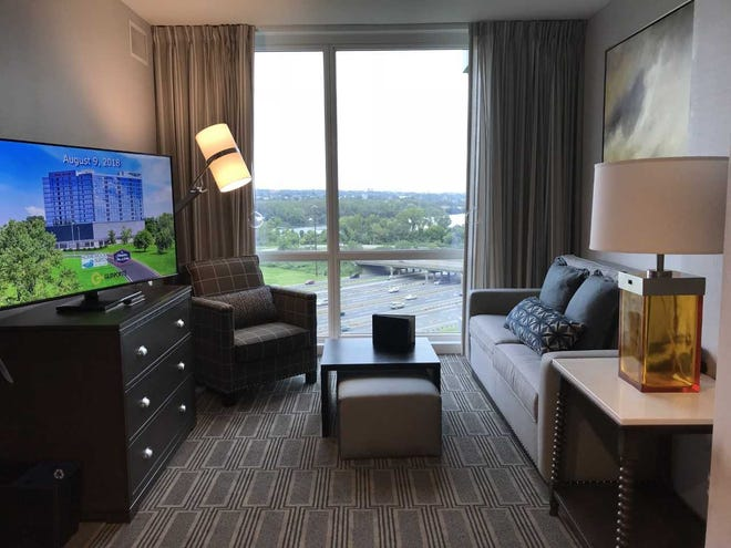 Pictured is a living room in a double-queen room in Homewood Suites by Hilton Teaneck Glenpointe.