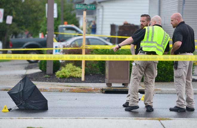 Investigators at the scene where a pedestrian was struck and killed by a car while crossing Broadway in Elmwood Park on Tuesday morning.