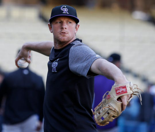 Colorado Rockies second baseman DJ LeMahieu warms up before a baseball game against the Los Angeles Dodgers in Los Angeles, Monday, Sept. 17, 2018. (AP Photo/Alex Gallardo)
