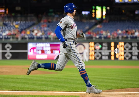 New York Mets center fielder Brandon Nimmo (9) scores during the second inning against the Philadelphia Phillies at Citizens Bank Park.