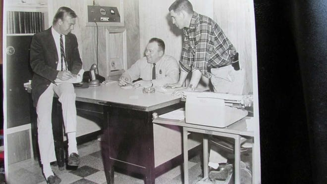 Wanaque Police Officers who investigated the murder of Judge Joseph James Crescente in 1974 are Dave Sisco (center) and Joseph Cisco (right) talking with a reporter a few years later. Sisco became Wanaque Police Chief and Cisco was North Jersey District Water Supply Co. Security Chief for 18 years. Sisco died in 2002 and Cisco passed on in 2007.
