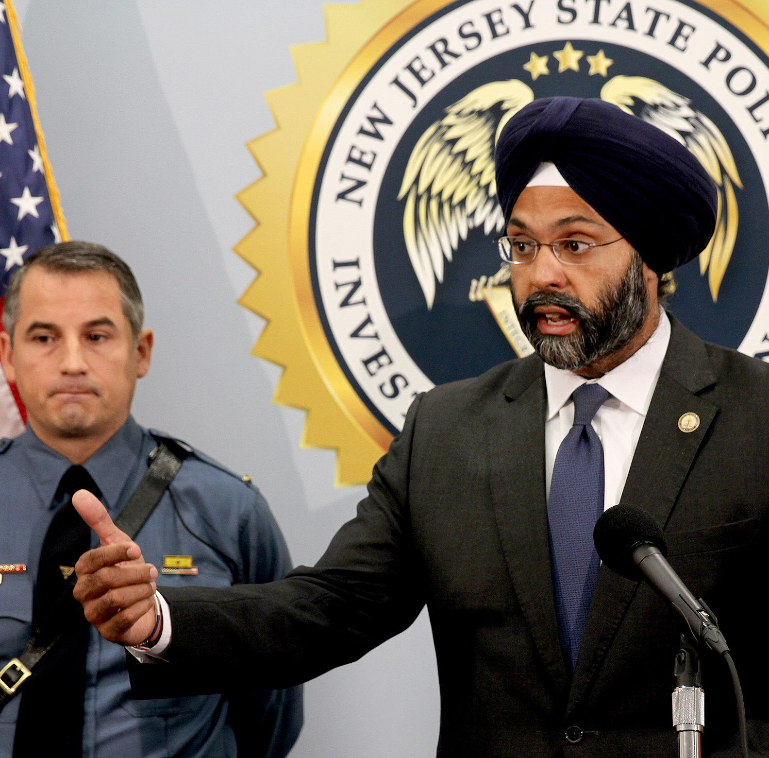 "NJ Attorney General Gubir S. Grewal makes an announcement Tuesday, September 18, 2018, about the arrest of 24 alleged child predators during ""Operation Open House.""  Behind him is ICAC Commander Lt. John Pizzuro, who heads the State Police's Digital Technology Investigation Unit."