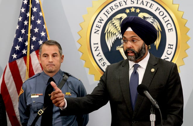 """NJ Attorney General Gubir S. Grewal makes an announcement Tuesday, September 18, 2018, about the arrest of 24 alleged child predators during """"Operation Open House.""""  Behind him is ICAC Commander Lt. John Pizzuro, who heads the State Police's Digital Technology Investigation Unit."""