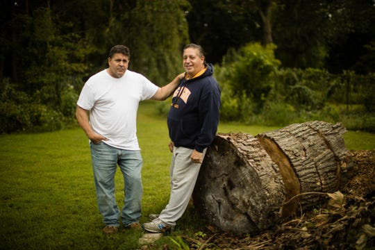 Anthony Torres, right, poses for a photograph with his brother Tom Torres, in Atco, N.J., Monday, Sept. 17, 2018. Anthony Torres says he was the rider caught shaving on a New Jersey Transit train in a video that went viral, explaining that he was just trying to clean up after days spent in a homeless shelter. (AP Photo/Matt Rourke)