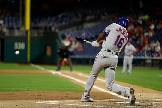 New York Mets' Austin Jackson follows through after hitting an RBI-double off Philadelphia Phillies starting pitcher Jake Arrieta during the second inning of a baseball game, Monday, Sept. 17, 2018, in Philadelphia.