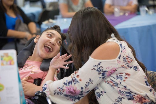 Seriyah Borunda, 16, left, smiles at her sister, Glory Borunda, 15, at a celebration party at Memorial Medical Center on Monday Sept. 17, 2018.
