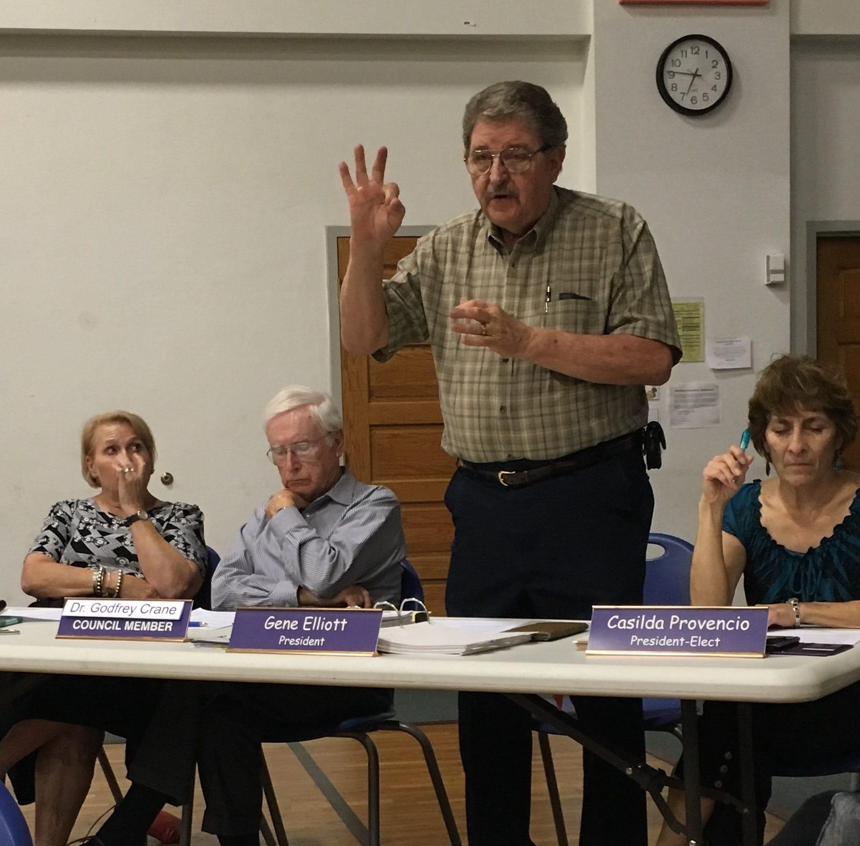 From left, Alma d'Arte principal Holly Schullo and governing council members Karen Caroe, Godfrey Crane, Gene Elliott (speaking), and Casilda Provencio.