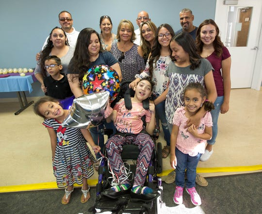 Seriyah Borunda, 16, center, along with her family and some hospital staff at a celebration party at Memorial Medical Center on Monday, Sept. 17, 2018.
