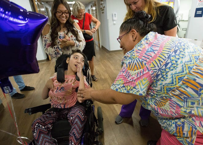 Seriyah Borunda, 16, center,  is greeted by Pricilla Maldonado, right, during a tour Monday Sept. 17, 2018, of Memorial Medical Center to visit with hospital staff that donated to Seriyah's Make-A-Wish campaign.