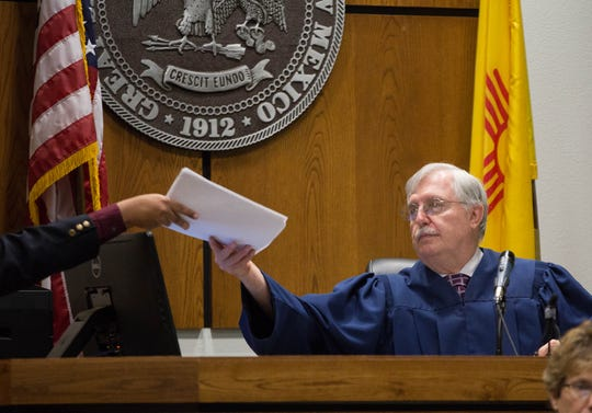 Third Judicial District Court Judge Douglas Driggers is handed a verdict on Tuesday, Sept. 18, 2018 in the case of the state of New Mexico vs. Joe Azure, who was suspected of breaking into his ex-girlfriends home and breaking 27 bones in her face. The jury issued a verdict of not guilty to aggravated burglary and larceny. A misdemeanor charge is still pending against Azure, while an attempted murder charge was dropped Monday by 3rd Judicial District Attorney's Office prosecutors.