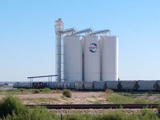 The Occidental Petroleum (OXY) FOB Transload Facility and frac sand storage silos.