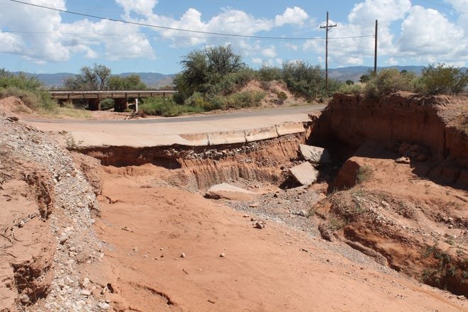 The section of Riata Road shown here, between Canary Lane and High Mesa Road, is the subject of frequent flooding due to the dip in the road and the arroyo running under the train trestle in the left of the photo. Construction of a bridge spanning this gap is slated to begin in March.