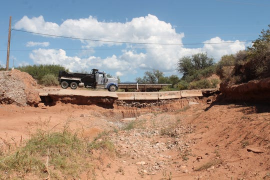 The dip on Riata Road, shown with a dump truck for scale, as seen facing east.