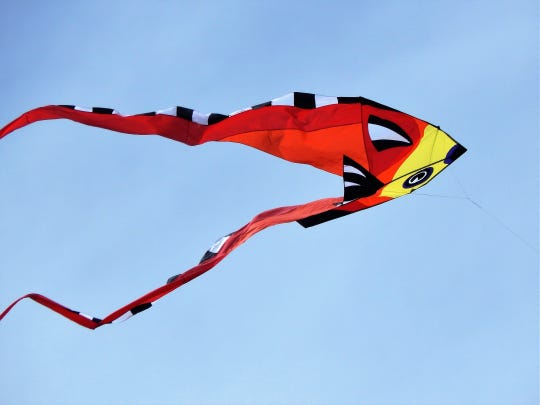 Shapes and colors fly high above moving through the wind at the Ruidoso Kite Festival.