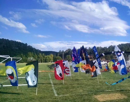 Flags blow in the wind at the White Mountain Complex during the Ruidoso Kite Festival bringing all the colors of the rainbow to an exciting day for young and old.