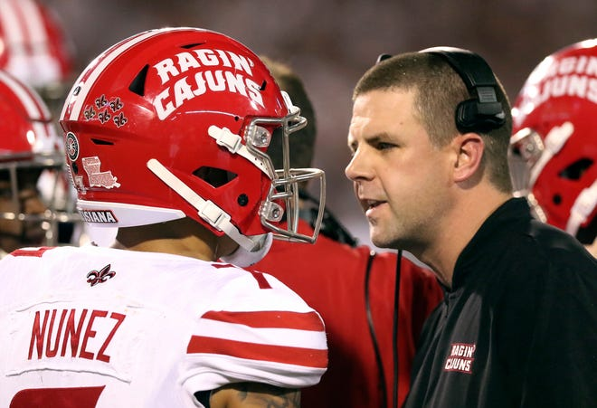 UL football coach Billy Napier talks to quarterback Andre Nunez (7) during the first half of Saturday's game against Mississippi State in Starkville, Mississippi.