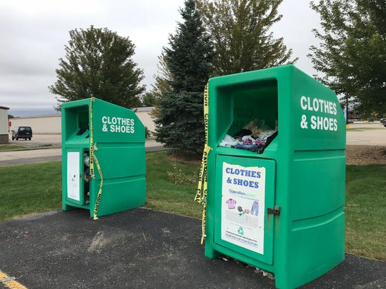 Property owners cleared away the pile of unwanted items by Tuesday morning, but the clothes remained.