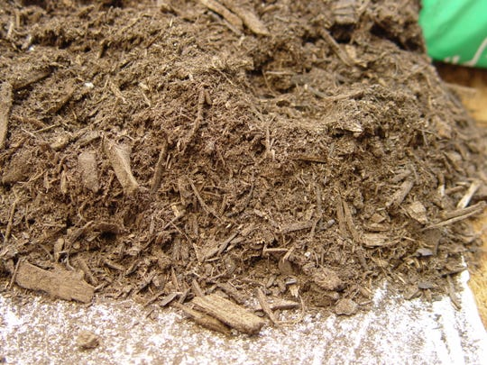 Many cheaper potting soils are mostly ground up woody matter which should be augmented with compost and manures to bump fertility.