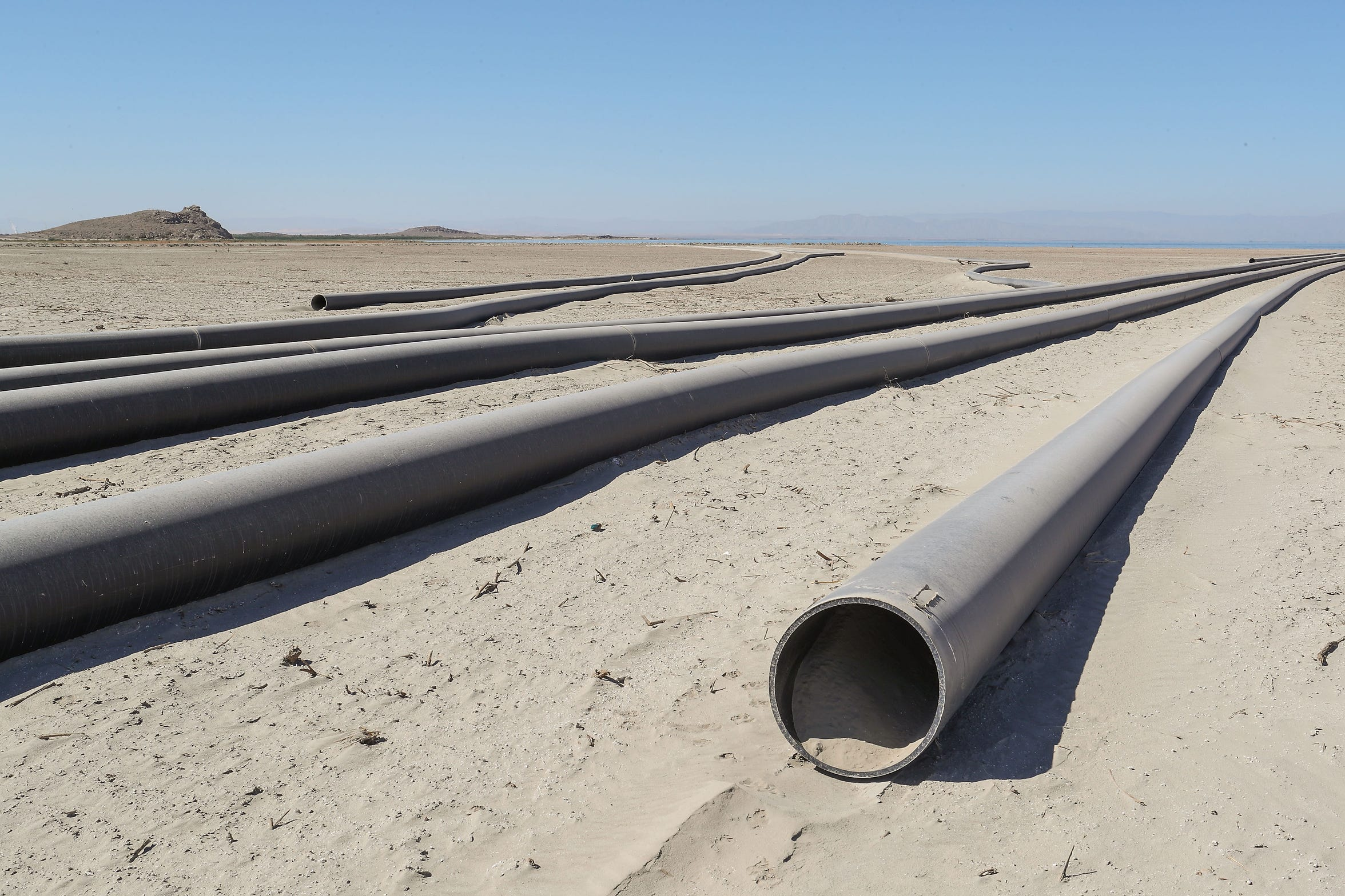 Large pipes will bring Salton Sea water inland to Red Hill Bay, where it will be mixed with fresh water from the Alamo River to create wetland bird habitat. The pipes are seen here on Sept. 12, 2018.