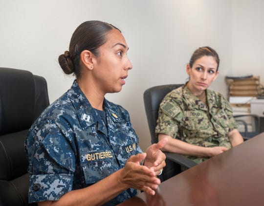 From left, Lt. Juliana Gutierrez and Lt. Cynthia Dehart, both nurses, talk Tuesday about the services available at the new Comprehensive Women's Health Center at Pensacola Naval Hospital.