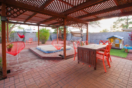 Poon and Domingo's colorful backyard, a space for the couple to unplug, includes a play area for their daughter, which guests with families use when staying in Betty.