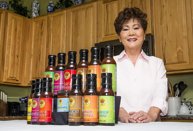 Kay Weldon of Mesa created Korean cooking sauces that Walmart had agreed to market.  She shows off the first sauce she made, AHSSA Gourmet Korean Sweet and Tangy.