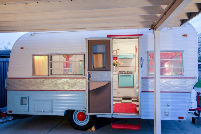 A checkered floor welcomes anyone who steps inside the dainty camper.