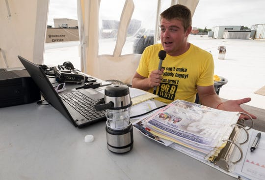 Q Country 107 WSAQ host Matt Markham broadcasts live from the roof of the Michigan Mutual building in downtown Port Huron Tuesday, Sept. 18, 2018, during the annual Community Roof-Sit for Kids.