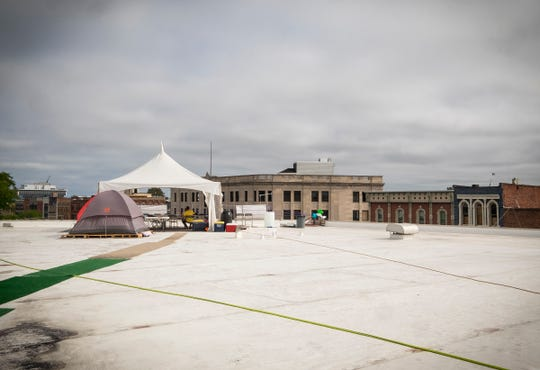 Q Country 107 WSAQ host Matt Markham sits under a tent on the roof of the Michigan Mutual building in downtown Port Huron Tuesday, Sept. 18, 2018, during the annual Community Roof-Sit For Kids. Markham will stay on the roof until 6 p.m. Friday unless there is lightning.
