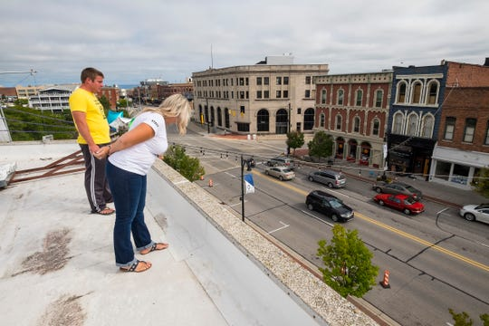 Q Country 107 WSAQ host Matt Markham, left, and CAN Council Executive Director Sherry Archibald look over Military Street from the roof of the Michigan Mutual building Tuesday, Sept. 18, 2018, during the annual Community Roof-Sit for Kids. This year, the event moved from the Birchwood Mall to downtown Port Huron.