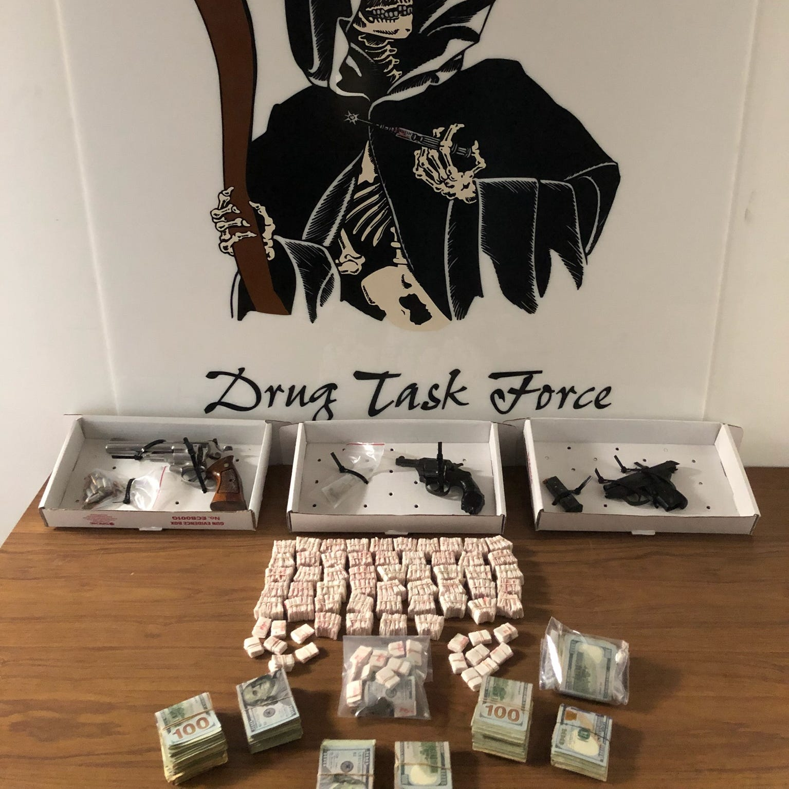 Three handguns, more than 2,000 bags of heroin, drug paraphernalia, and over $11,000 cash was recovered in a raid, according to the Dutchess County Drug Task Force.