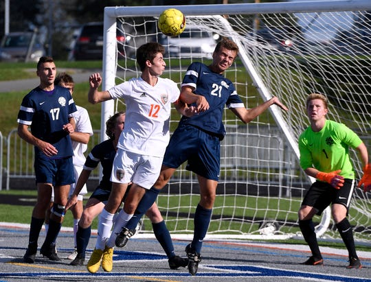 Central York's Zach Favorin (12) and Mitchell Groh of Dallastown battle for a thrown ball in front of the Wildcat's goal, Tuesday, Sept. 18, 2018. John A. Pavoncello photo