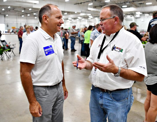 Rep. Lloyd Smucker, left, who is running for the 11th District, talks with York Fair Director Greg Saubel during York Fair in West Manchester Township, Saturday, Sept. 15, 2018. Dawn J. Sagert photo