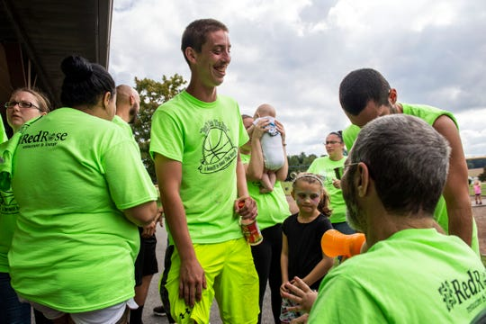 Tyler Myers, center, laughs while speaking with Chad's dad, Rich Merrill, right, after the 'Don't Hate the Race' basketball tournament on Saturday, September 15, 2018. The 3-on-3 event was organized to honor Chad Merrill, who was shot and killed on July 21 outside the Red Rose Restaurant & Lounge.