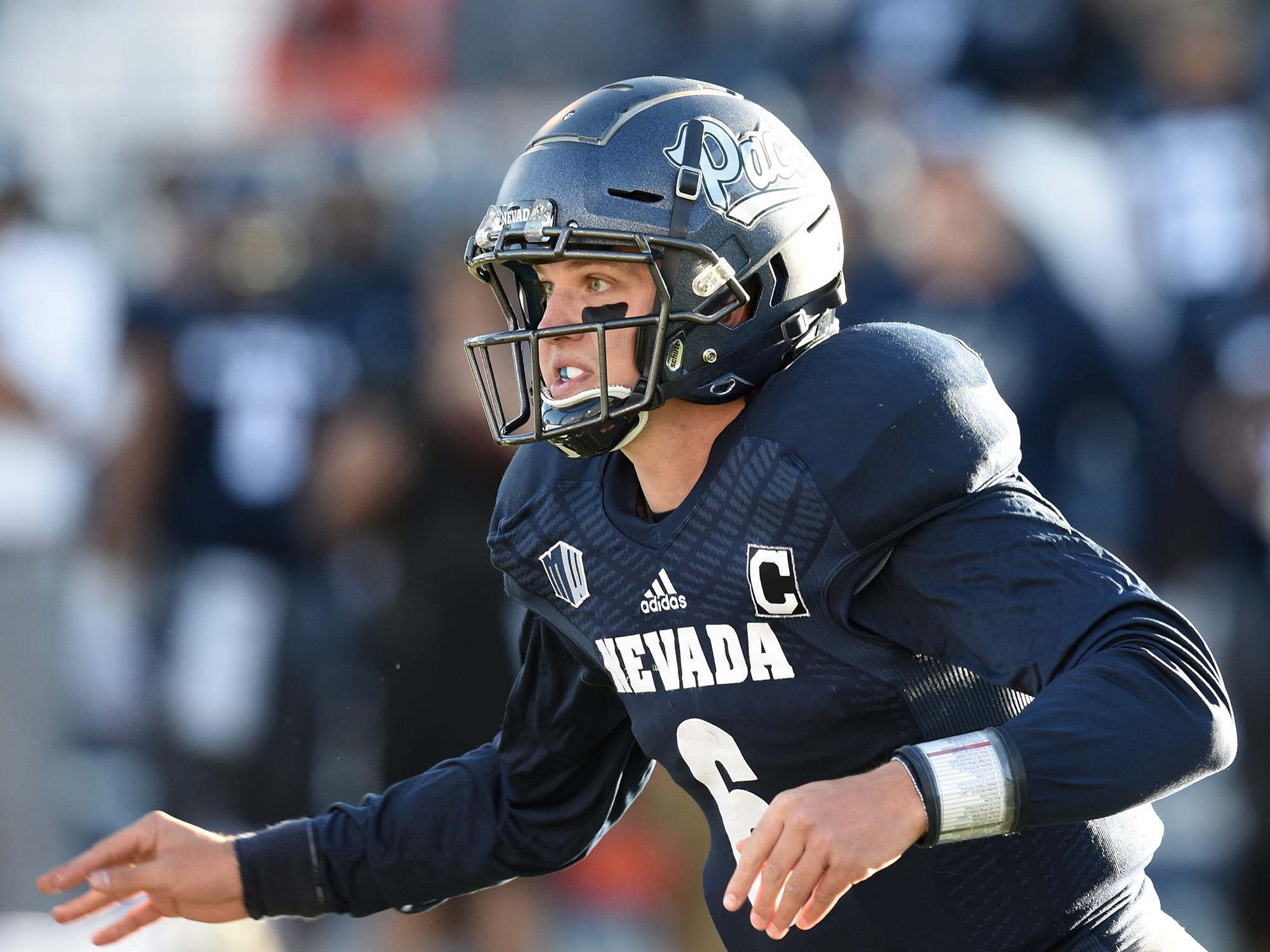Nevada QB Ty Gangi watches a hand-off he made against Oregon State   at Mackay Stadium on Sept. 15, 2018.