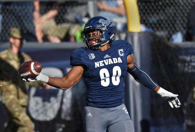 Nevada defensive end Malik Reed celebrates a touchdown after an Oregon State fumble earlier this season.