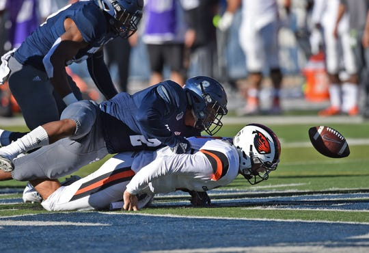 Nevada's Asauni Rufus forces Oregon State quarterback Conor Blount to fumble during the teams' September game at Mackay Stadium.
