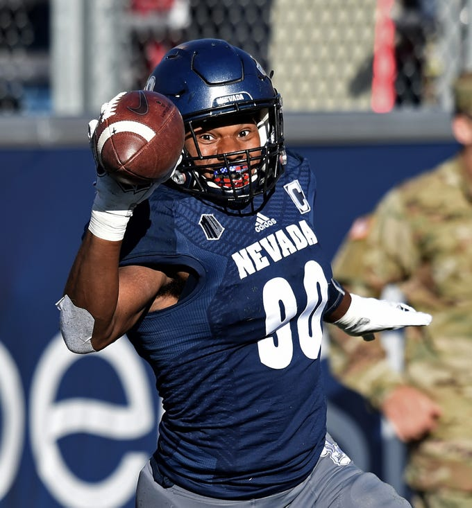 Nevada DE Malik Reed scores after picking up a fumble by Oregon State QB at Mackay Stadium on Sept. 15, 2018.